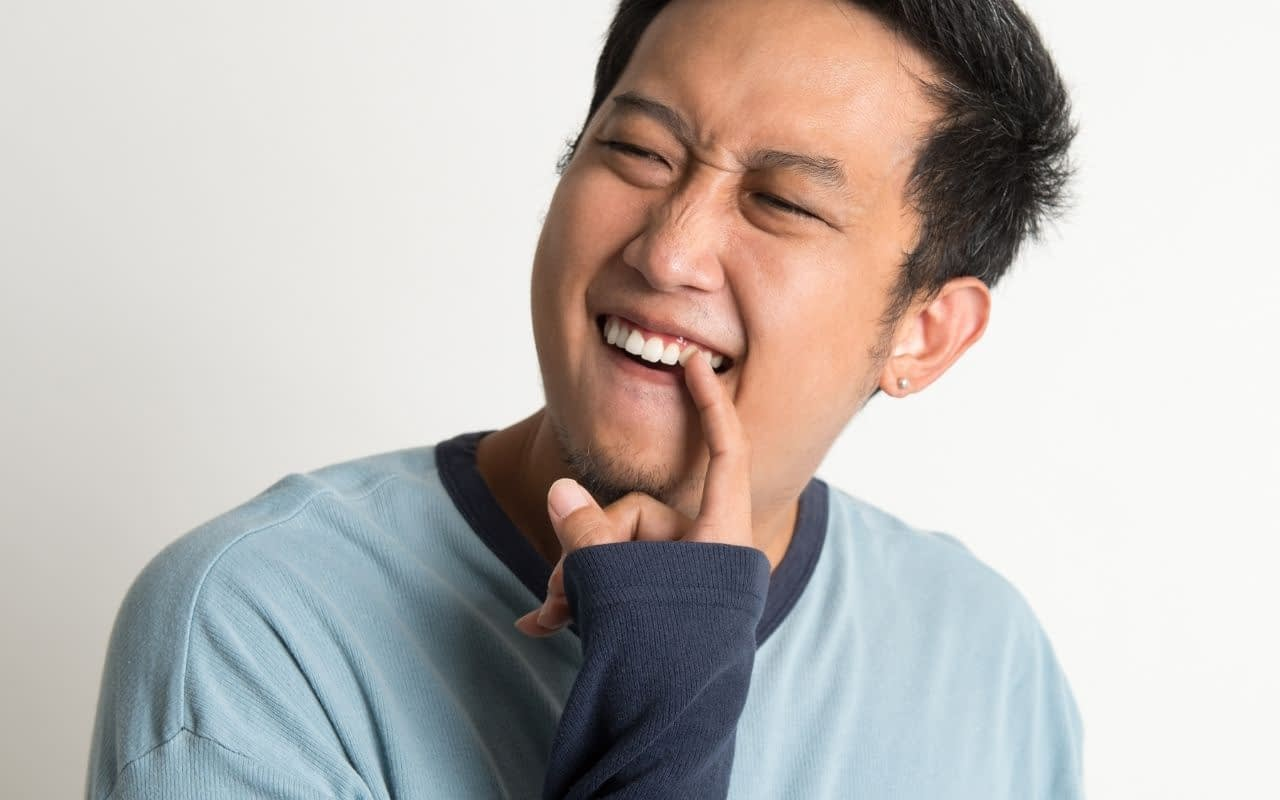 dont-ignore-something-stuck-between-your-teeth-Etobicoke-Dentist