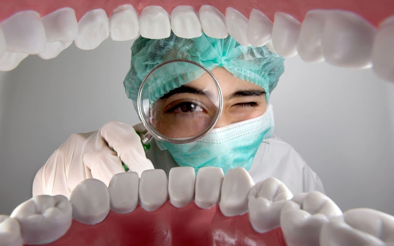do-call-the-dentist-if-you-experience-something-new-in-your-mouth-Li-Dental